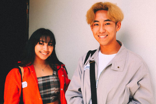 Emmanuel and Darianna - student in red jacket and blond mid-part short hair