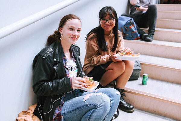 Megan - An - student in leather jacket and student with fringe and glasses