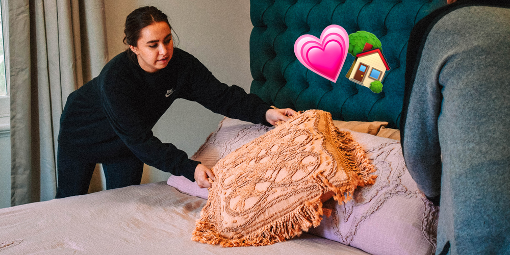 Student adjusting pillow on a bed