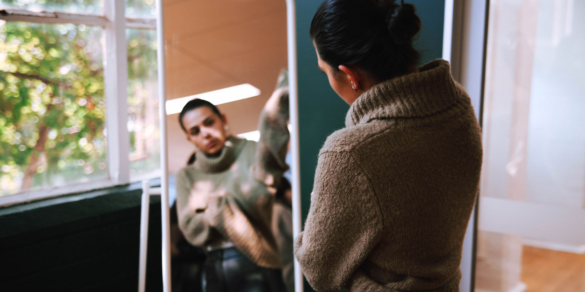 Wearing jumper in the mirror reflection